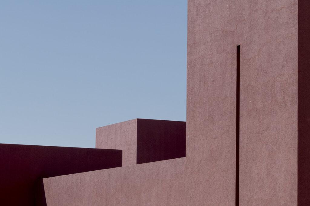 Square shaped buildings against blue sky