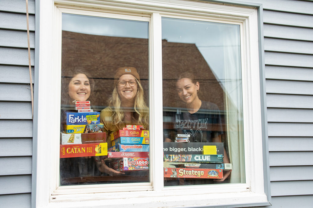 Holding board games at the window