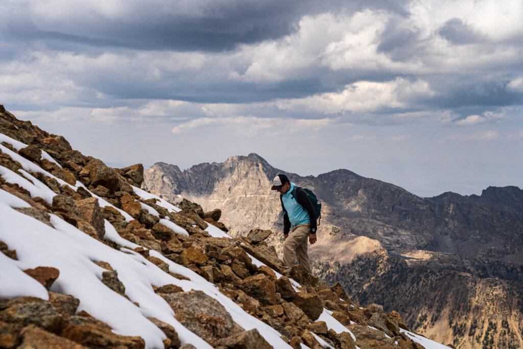 Man climbing up mountain with snow