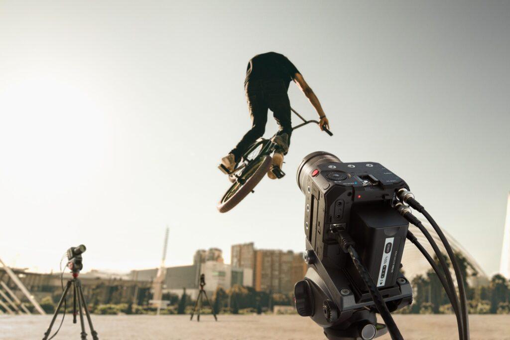 Man biking with LUMIX BGH1 in foreground