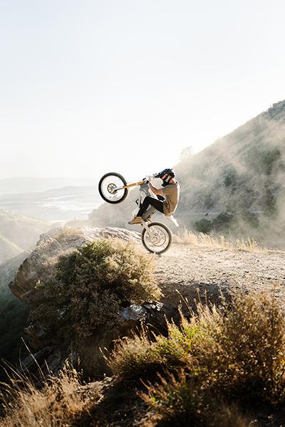 Man popping a wheelie on bike